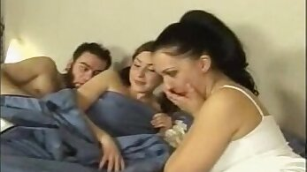 Lesbian action takes place in Russian dorm room on threesome