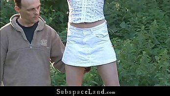 Beautiful slave tied up outdoors