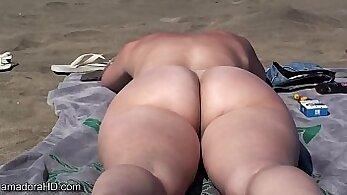 Candid voyeur booty on beach, navy neck, skinny legs