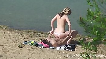 Couple Has Fun With One Young Ebony Stud On A Beach