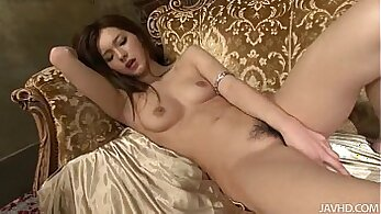 Curly haired Japanese girl Kobitas gets her pussy plugged up with toy
